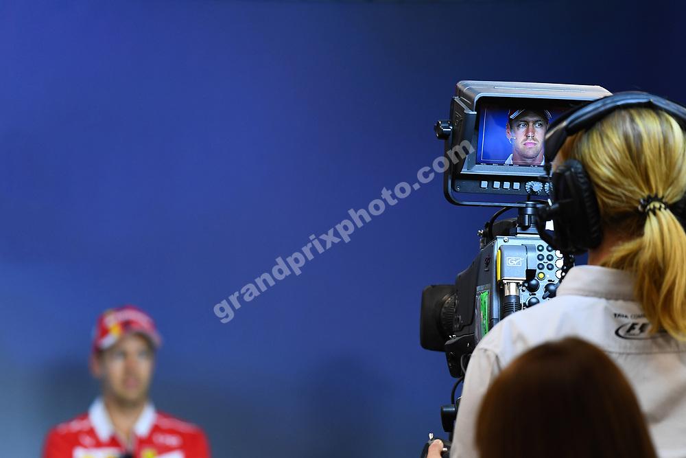 Sebastian Vettel (Ferrari) seen through camerea during press conference before the 2017 Austrian Grand Prix at the Red Bull Ring in Spielberg. Photo: Grand Prix Photo