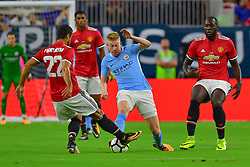 Manchester United midfielder Henrikh Mkhitaryan (22) and Manchester City midfielder Kevin De Bruyne (17) both try to win the ball during play a the International Champions Cup match between Manchester United and Manchester City at NRG Stadium in Houston, Texas