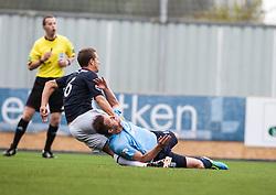 Falkirk's Will Vaulks holds Dundee's Steven Doris.<br /> half time : Falkirk 1 v 0 Dundee, 21/9/2013.<br /> ©Michael Schofield.