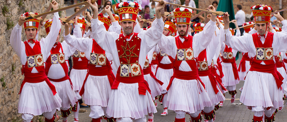Dancers in procession through the streets during San Fermin Fiesta at Pamplona, Navarre, Northern Spain