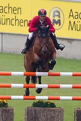 Schwizer Pius (SUI) - Carlina<br /> World Equestrian Festival, CHIO Aachen 2011<br /> © Dirk Caremans
