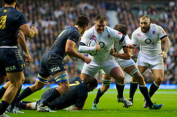 England Prop (#3) David Wilson (Bath Rugby) goes for the line as Argentina Flanker (#7) Julio Farias Cabello (Tucuman) tackles during the first half of the match - Photo mandatory by-line: Rogan Thomson/JMP - Tel: Mobile: 07966 386802 09/11/2013 - SPORT - RUGBY UNION -  Twickenham Stadium, London - England v Argentina - QBE Autumn Internationals.