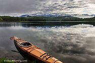 Wooden kayak on shore of Beaver Lake near Whitefish, Montana, USA