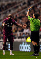 Photo: Jed Wee.<br /> Newcastle United v Bolton Wanderers. The Barclays Premiership. 15/10/2006.<br /> <br /> Bolton's El Hadji Diouf (L) is booked by referee Alan Wiley.