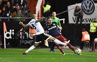 Valencia's Sofiane Feghouli and Atletico de Madrid´s Filipe Luis during 2015/16 La Liga match between Valencia and Atletico de Madrid at Mestalla stadium in Madrid, Spain. March 6, 2016. (ALTERPHOTOS/Javier Comos)