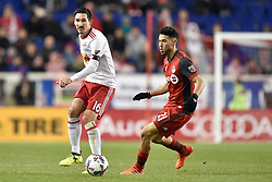 October 30, 2017 - Harrison, New Jersey, U.S - New York Red Bulls midfielder SACHA KLJESTAN (16) passes as Toronto FC midfielder JONATHAN OSORIO (21) defends at Red Bull Arena during the Audi 2017 MLS Cup Playoffs Eastern Conference Semifinal in Harrison New Jersey Toronto defeats New York 2 to 1 (Credit Image: © Brooks Von Arx via ZUMA Wire)