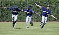 July 6, 2017 - Chicago, IL, USA - Milwaukee Brewers outfielders, from left, Keon Broxton, Domingo Santana and Hernan Perez celebrate an 11-2 win against the Chicago Cubs at Wrigley Field Thursday, July 7, 2017, in Chicago. (Credit Image: © John J. Kim/TNS via ZUMA Wire)