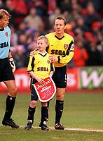 Lee Dixon with the Arsenal mascot. Liverpool 4:0 Arsenal, FA Carling Premiership, 23/12/2000. Credit Colorsport / Stuart MacFarlane.