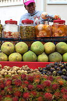 Phnom Penh Fruit Vendor - Although Cambodia may be lacking industrial prowess and luxury goods, there is one thing in abudance and that is a wide variety of tropical fruits.