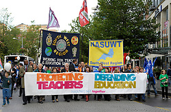 © Licensed to London News Pictures. 17/10/2013.  Bristol, UK.  Teachers go on a one day strike in the south west of England in a series of strikes across the UK against plans by Government Minister Michael Gove to change teachers' pay, hours and pensions.  The strike was organised by the NUT and NASUWT trade unions, and teachers marched through the centre of Bristol to hold rallies. 17 October 2013.<br /> Photo credit : Simon Chapman/LNP
