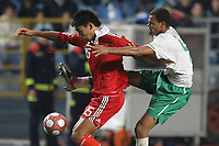 20100303: COIMBRA, PORTUGAL - Portugal vs China: International Friendly. In picture: Rolando (Portugal) and Zhang Chengdong (China). PHOTO: CITYFILES