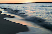 breaking waves at sunset on the shores of Lake Superior, Upper Peninsula of Michigan