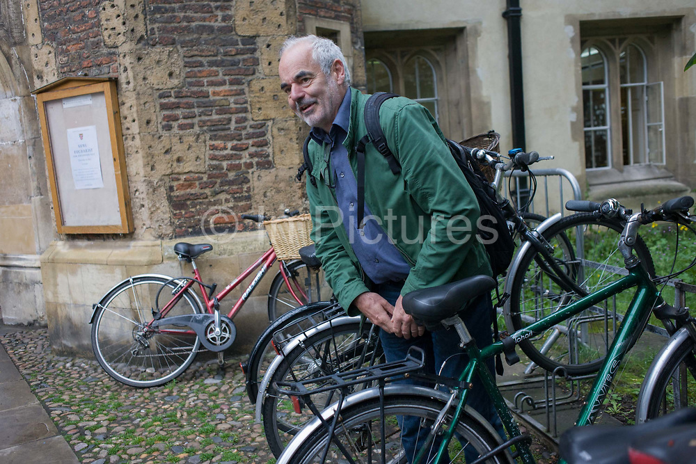 Mathematician and Risk guru, Professor David Spiegelhalter at the Centre for Mathematical Sciences, out and about with his bike in Cambridge. Sir David John Spiegelhalter (1953), OBE FRS, is a British statistician. In 2007 he was elected Winton Professor of the Public Understanding of Risk in the Statistical Laboratory, University of Cambridge and a Fellow of Churchill College, Cambridge. From the chapter entitled 'Possible Futures' and from the book 'Risk Wise: Nine Everyday Adventures' by Polly Morland (Allianz, The School of Life, Profile Books, 2015).