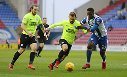 Danny Lloyd of Peterborough United in action with Cheyenne Dunkley of Wigan Athletic - Mandatory by-line: Joe Dent/JMP - 13/01/2018 - FOOTBALL - DW Stadium - Wigan, England - Wigan Athletic v Peterborough United - Sky Bet League One