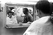 "Civil rights leader, politician, actor and former Chairman of the NAACP, Julian Bond, has died at age 75. Bond is reflected in the  makeup trailer mirror as he talks with folksinger Richie Havens during the filming of the 1977 feature film, ""Greased Lightning"".  The film starred Grier, Richard Pryor and Beau Bridges and chronicled the life of the first African American NASCAR driver - Wendell Scott."