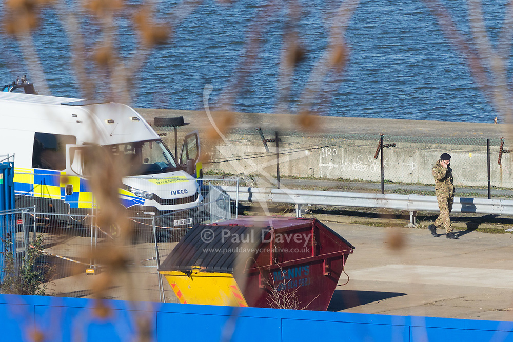 A view from a nearby building shows a royal Navy Bomb Disposal Unit vehicle and personnel at the site where an unexploded World War 2 bomb has been discovered in George V Dock, adjacent to London City Airport, Some local residents have been evacuated.  London, February 12 2018.