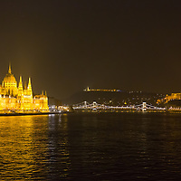 Photo of the Hungarian capitol city with the Parliament (L), Chain Bridge (C) and the Royal Castle (R) during the Earth Hour in Budapest, Hungary on March 23, 2013. ATTILA VOLGYI