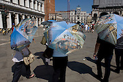 Tourist umbrellas in Piazza San Marco, Venice, Italy
