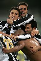 Verona 13/3/2005 Campionato Italiano Serie A <br /> Chievo Verona - Juventus 0-1 <br /> Ruben Olivera, naked to the waist, celebrated by his teammates FAbio Cannavaro (up) Zlatan Ibrahimovic (Center Left) and Gianluca Zambrotta (Center Right)<br /> Ruben Olivera festeggiato da  FAbio Cannavaro (up) Zlatan Ibrahimovic (Center Left) and Gianluca Zambrotta <br /> Photo Andrea Staccioli Graffiti