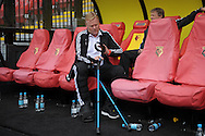 Ronald Koeman, the Southampton manager sorting out his crutches while sitting in the dugout before k/o. Barclays Premier League, Watford v Southampton at Vicarage Road in London on Sunday 23rd August 2015.<br /> pic by John Patrick Fletcher, Andrew Orchard sports photography.