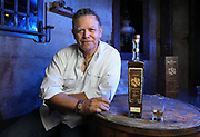 December 1, 2017_Carlsbad, California_USA_| Portrait of Phillip Soto Mares with a bottle of The Bad Stuff Tequila. He is the distiller and co-founder of The Bad Stuff Spirits. Photo taken in the Captain Charles Kenneth Speakeasy that's in the basement of the Land and Water Company restaurant. |_Mandatory Photo Credit: Photo by Charlie Neuman