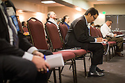 Attendees take notes during the Silicon Valley NAIFA 58th Annual Sales Congress at The Domain Hotel in Sunnyvale, California, on March 28, 2014. (Stan Olszewski/SOSKIphoto)