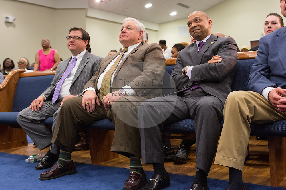 North Charleston Mayor Keith Summey listens to Rev. Al Sharpton address a healing service at Charity Missionary Baptist Church April 12, 2015 in North Charleston, South Carolina. Sharpton spoke following the recent fatal shooting of unarmed motorist Walter Scott police and thanked the Mayor and Police Chief for doing the right thing in charging the officer with murder.