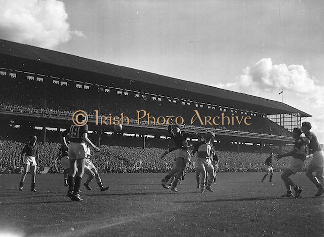 Ball flies between players during the All Ireland Senior Gaelic Football Final Down v. Offaly in Croke Park on the 24th September 1961.
