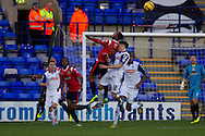 Walsall's Ashley Hemmings jumps with Tranmere Rovers James Rowe. Skybet football league 1 match, Tranmere Rovers v Walsall at Prenton Park in Birkenhead, England on Saturday 11th Jan 2014.<br /> pic by Chris Stading, Andrew Orchard sports photography.