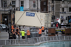 © Licensed to London News Pictures. 11/06/2021. London, UK. Work begins at Trafalgar Square in central London on the building of a new Fan Zone, ahead of the 2020 UEFA European Football Championship which kicks off later today. Fans will be able to watch England games on a giant screen in the centre of the capital. Photo credit: Ben Cawthra/LNP