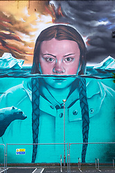 © Licensed to London News Pictures. 29/05/2019. Bristol, UK. GRETA THUNBERG giant mural. Bristol artist Jody puts the finishing touches to a giant mural of Greta Thunberg with Arctic water rising around her, flanked by a polar bear with an apocalyptic, heatwave polluted sky, painted onto the side of the Tobacco Factory in North Street, Southville. The work is part of the Upfest Summer Editions which will see all of the main Upfest walls being painted on again between April and October by a number of local, national and international street artists, while the main Upfest street art festival takes a break this year in preparation for 2020. All invited artists will be releasing special edition prints of the murals later in the year supporting the preparations for Upfest 2020. Greta Thunberg is a Swedish schoolgirl who, at age 15, began protesting about the need for immediate action to combat climate change outside the Swedish parliament and has since become an outspoken climate activist. She is known for having initiated the school strike for climate movement that formed in November 2018 and surged globally after the United Nations Climate Change Conference (COP24) in December the same year. On 15 March 2019 an estimated 1.4 million students in 112 countries around the world joined her call in striking and protesting. Thunberg has received various prizes and awards for her activism. In March 2019, three members of the Norwegian parliament nominated Thunberg for the Nobel Peace Prize. In May 2019, at the age of 16, she featured on the cover of Time magazine. Photo credit: Simon Chapman/LNP.