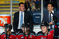 KELOWNA, BC - OCTOBER 12: Head coach Adam Foote stands on the bench next to assistant coach Vern Fiddler as Trevor Wong #8, Dillon Hamaliuk #22 and Nolan Foote #29 of the Kelowna Rockets share a laugh on the bench against the Kamloops Blazers at Prospera Place on October 12, 2019 in Kelowna, Canada. (Photo by Marissa Baecker/Shoot the Breeze)