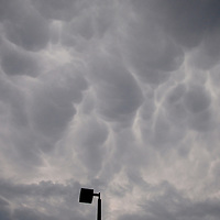 Andrew Knapp, FLORIDA TODAY -- June 14, 2011 -- Mammatus clouds form Tuesday afternoon over the Suntree area. The clouds sometimes are spotted underneath anvil clouds associated with thunderstorms.