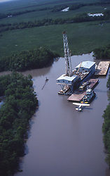 Stock photo of a barge rig with float plane in south Louisiana waterway