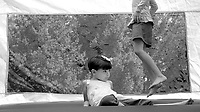 While attending the annual McLean Day celebration with their families, several children enjoy the moonbounce.