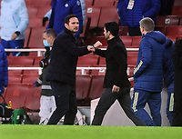 Football - 2020 / 2021 Premier League - Arsenal v Chelsea - Emirates Stadium<br /> <br /> Arsenal manager, Mikkel Arteta console Chelsea manager, Frank Lampard at the final whistle<br /> <br /> COLORSPORT/ANDREW COWIE