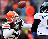 Matt Roth of the Browns puts pressure on Jacksonville quarterback David Garrard.