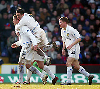 Photo: Scott Heavey<br />Crystal Palace V Leeds Ytd. 16/02/03<br />The Leeds team celebrate with goalscorer Harry Kewell during this FA cup 5th round clash.