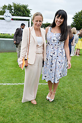 Left to right, ASTRID HARBORD and MELISSA HEMSLEY at day 3 of the Qatar Glorious Goodwood Festival at Goodwood Racecourse, Chechester, West Sussex on 28th July 2016.