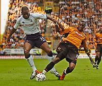 Photo. Jed Wee, Digitalsport<br /> NORWAY ONLY<br /> <br /> Wolverhampton Wanderers v Tottenham Hotspurs, FA Barclaycard Premiership, 15/05/2004.<br /> Wolves' Henri Camara (R) and Spurs' Anthony Gardner challenge for possession.
