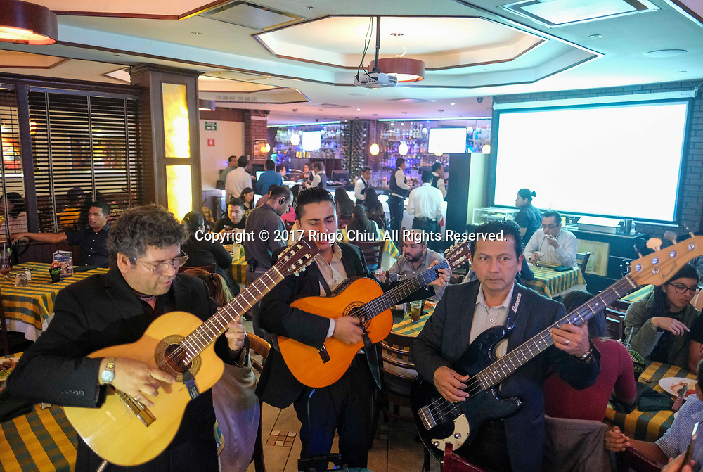 Mexican performers sing at a restaurant in Tijuana, Mexico on Thursday April 20, 2017. (Xinhua/Zhao Hanrong)
