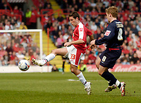 Photo: Leigh Quinnell.<br /> Bristol City v Nottingham Forest. Coca Cola League 1. 31/03/2007. Bristol Citys Lee Johnson gets to the ball before Forests Kris Commons.
