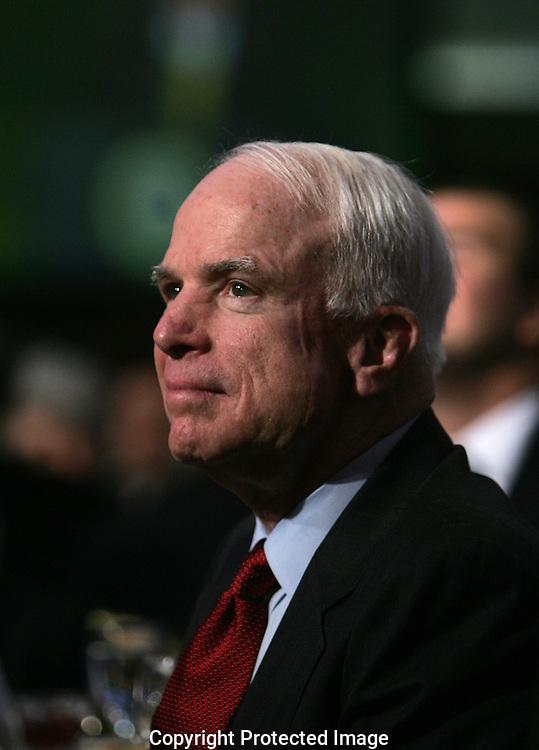 Republic Presidential candidate Senator John McCain wwatches President Bush during the National Prayer Breakfast On February 7, 2008.  Photo by Dennis Brack