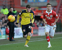 Fleetwood Town's Liam Mcslinfrn vies for possession with Bristol City's Joe Bryan<br /> <br /> Photographer Ashley Crowden/CameraSport<br /> <br /> Football - The Football League Sky Bet League One - Bristol City v Fleetwood Town - Sunday 1st February 2015 - Ashton Gate - Bristol<br /> <br /> © CameraSport - 43 Linden Ave. Countesthorpe. Leicester. England. LE8 5PG - Tel: +44 (0) 116 277 4147 - admin@camerasport.com - www.camerasport.com