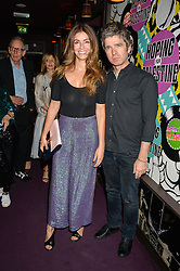 NOEL GALLAGHER and SARA MACDONALD at Hoping's Greatest Hits - the 10th Anniversary of The Hoping Foundation's charity benefit held at Ronnie Scott's, 47 Frith Street, Soho, London on 16th June 2016.