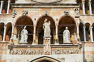 Statue of the Modonna with Child on the  facade of the Romanesque Cathedral of Cremona, begun 1107, with later Gothic, Renaissance & Baroque elements, Cremona, Lombardy, northern Italy .<br /> <br /> Visit our ITALY HISTORIC PLACES PHOTO COLLECTION for more   photos of Italy to download or buy as prints https://funkystock.photoshelter.com/gallery-collection/2b-Pictures-Images-of-Italy-Photos-of-Italian-Historic-Landmark-Sites/C0000qxA2zGFjd_k<br /> <br /> <br /> Visit our MEDIEVAL ART PHOTO COLLECTIONS for more   photos  to download or buy as prints https://funkystock.photoshelter.com/gallery-collection/Medieval-Middle-Ages-Art-Artefacts-Antiquities-Pictures-Images-of/C0000YpKXiAHnG2k