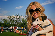 Moscow, Russia, 08/07/2005..Partygoer and her dog at the Europa Plus beach party at the Pokrovka Bereg Beach Club on the Moscow River.