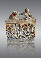 Etruscan Hellenistic style cinerary, funreary, urn ,  National Archaeological Museum Florence, Italy , against grey .<br /> <br /> If you prefer to buy from our ALAMY PHOTO LIBRARY  Collection visit : https://www.alamy.com/portfolio/paul-williams-funkystock - Scroll down and type - Etruscan Florence - into LOWER search box. (TIP - Refine search by adding a background colour as well).<br /> <br /> Visit our ETRUSCAN PHOTO COLLECTIONS for more photos to download or buy as wall art prints https://funkystock.photoshelter.com/gallery-collection/Pictures-Images-of-Etruscan-Historic-Sites-Art-Artefacts-Antiquities/C0000GgxRXWVMLyc