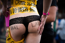© Licensed to London News Pictures . 26/08/2016 . Manchester , UK . A man in drag with ANAL LAND written on the cheeks of his bottom on Canal Street in Manchcester's Gay Village for 2016 Manchester Gay Pride Big Weekend . Photo credit : Joel Goodman/LNP