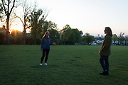 At the beginning of another week of Coronavirus pandemic lockdown, when the government is considering its options for a gradual opening of business with social distancing, during their daily exercise in Ruskin Park in south London, two women friends hold a conversation while observing social distancing of the two metres recommended by the government, on 4th May 2020, in Lambeth, London, England.